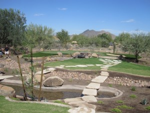 Turf, water feature and custom golf putting greens