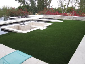 Elegance with sythetic grass and fabulous water features