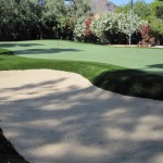 Custom residential putting green with bunker
